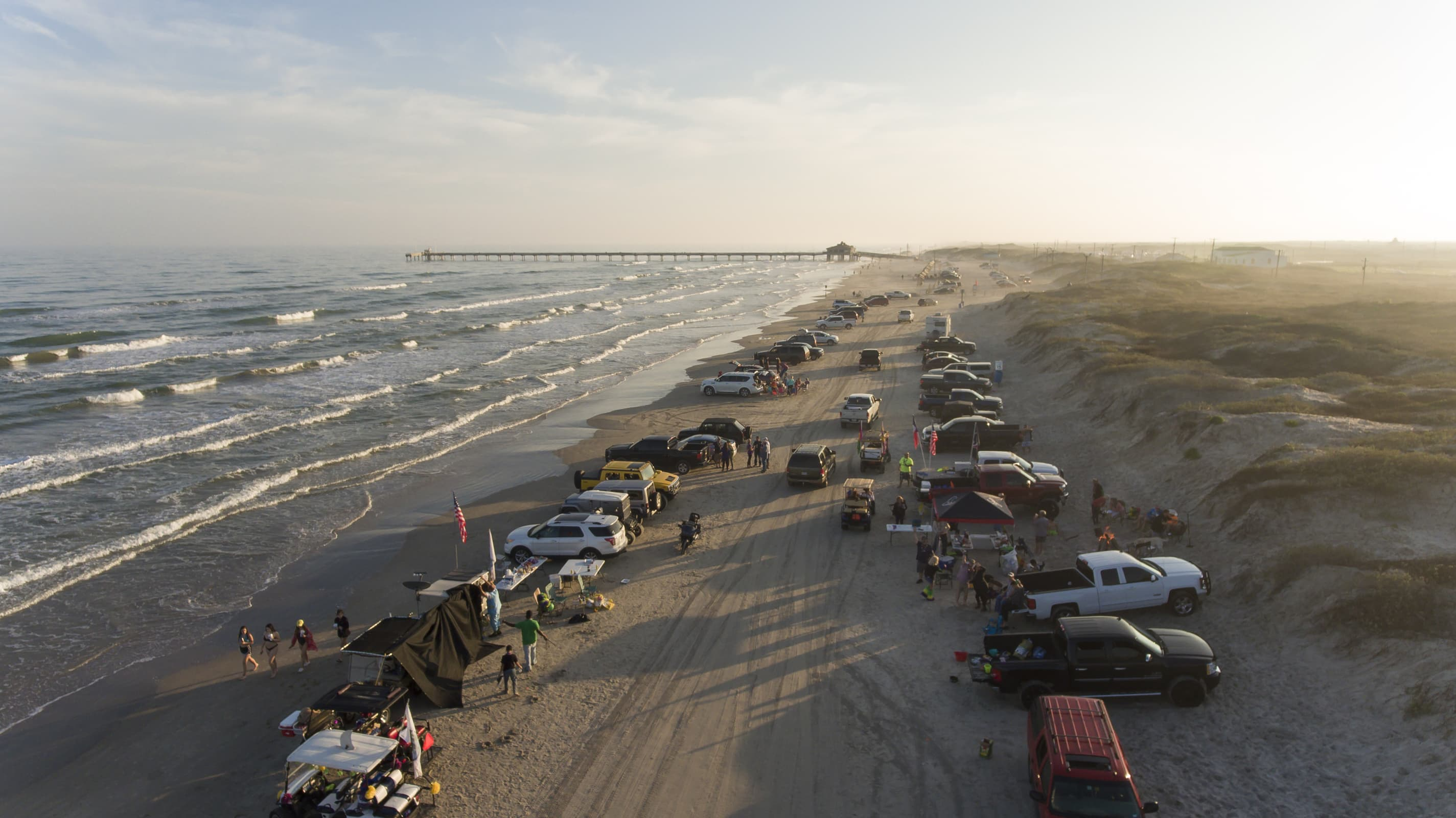 An aerial photo of Whitecap Beach at sunset