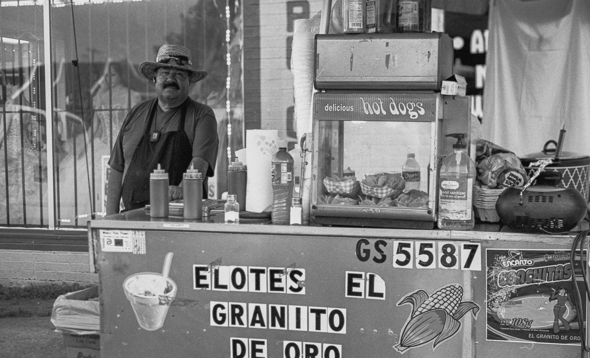 A man selling elotes