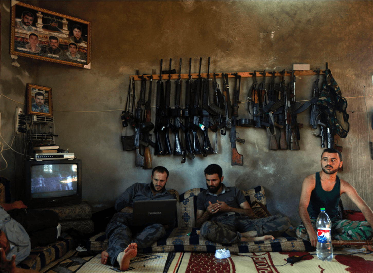 Free Syrian Army fighters sit in a house on the outskirts of Aleppo, Syria, June 12, 2012. (Khalil Hamra, Associated Press - June 12, 2012)