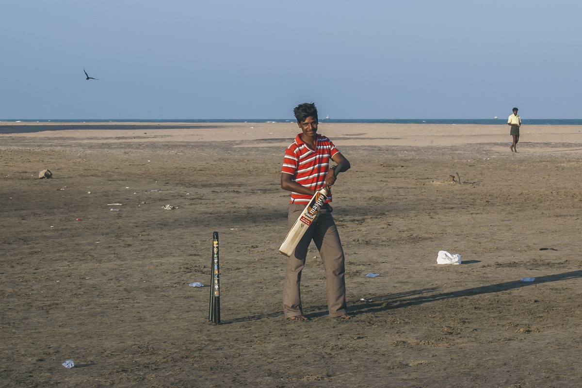 A man playing Cricket on Nagapattinam Beach