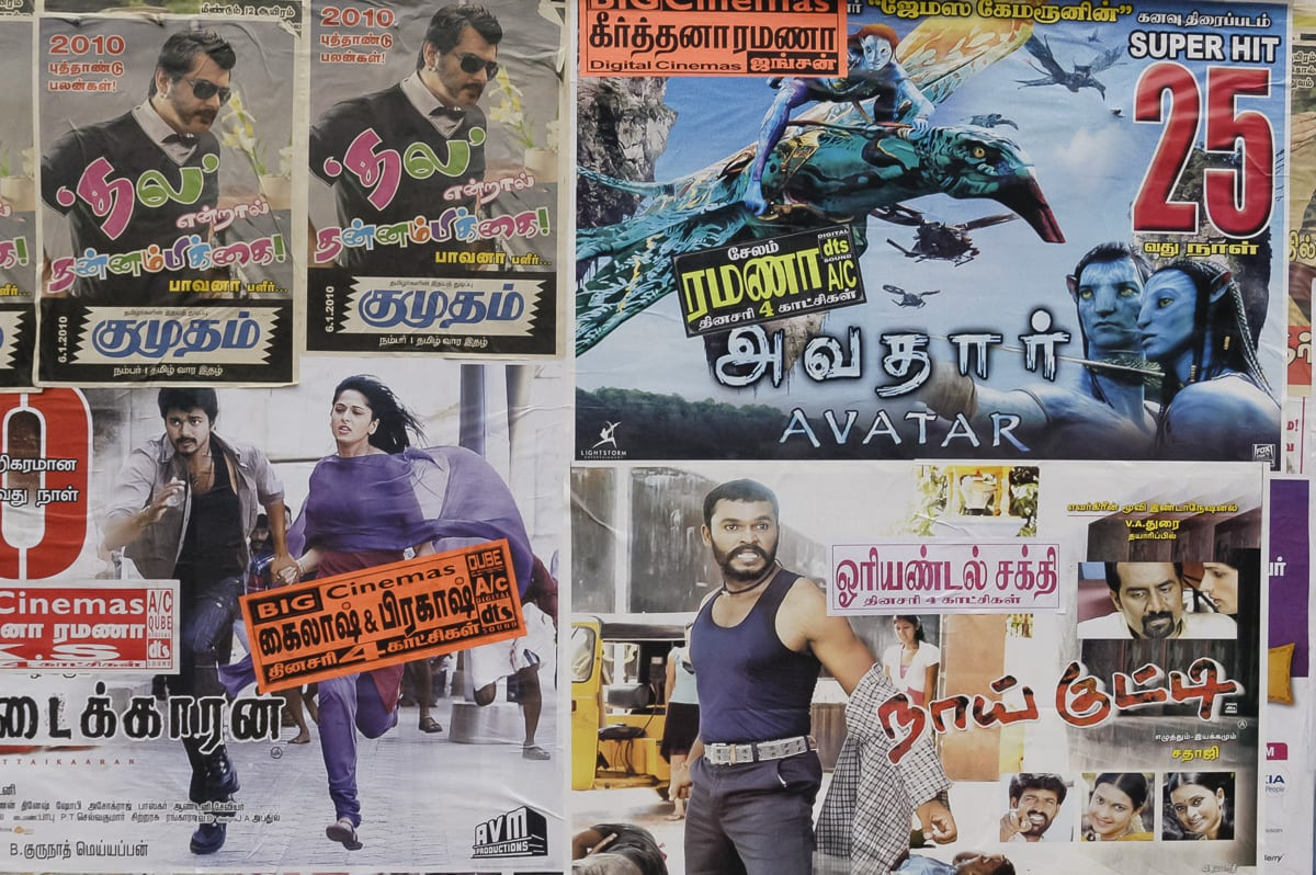 A wall of movie posters feating both Bollywood and Hollywood movies in Salem, India