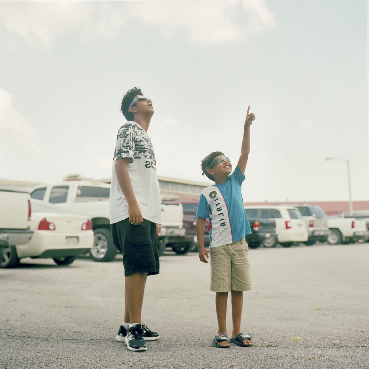 An analog portrait of two brothers watching the event in Carbondale, Illinois