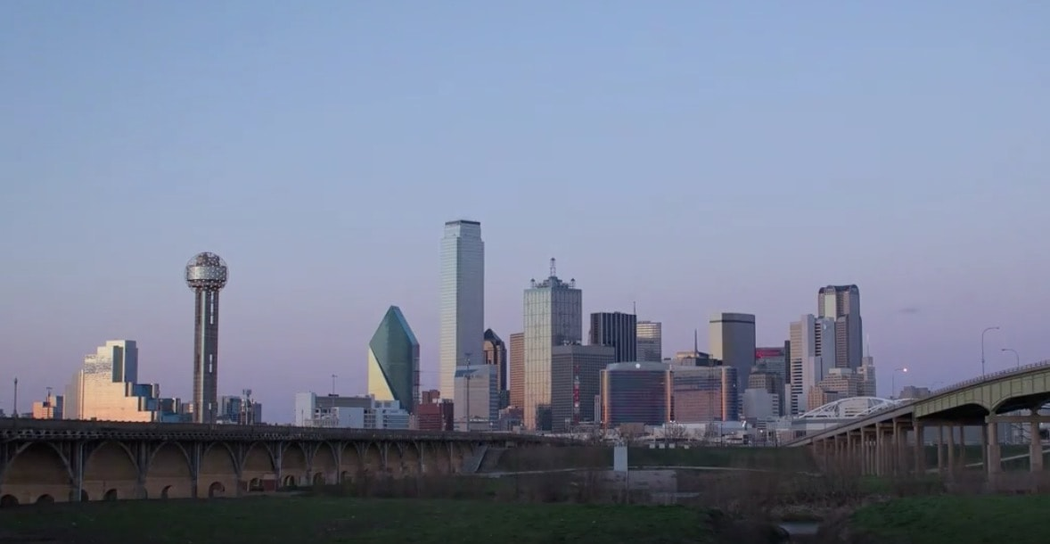 Time-lapse of the Sun Setting Over the Dallas Skyline
