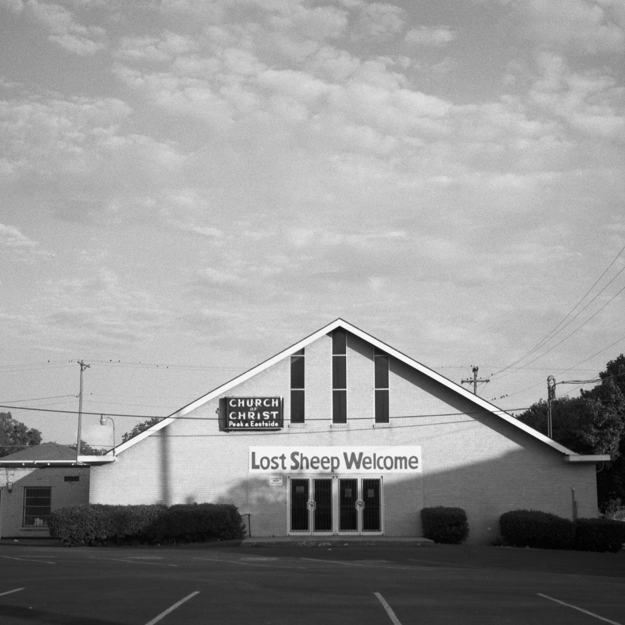 A church with the sign, Lost Sheep Welcome in the Old East Dallas neighborhood