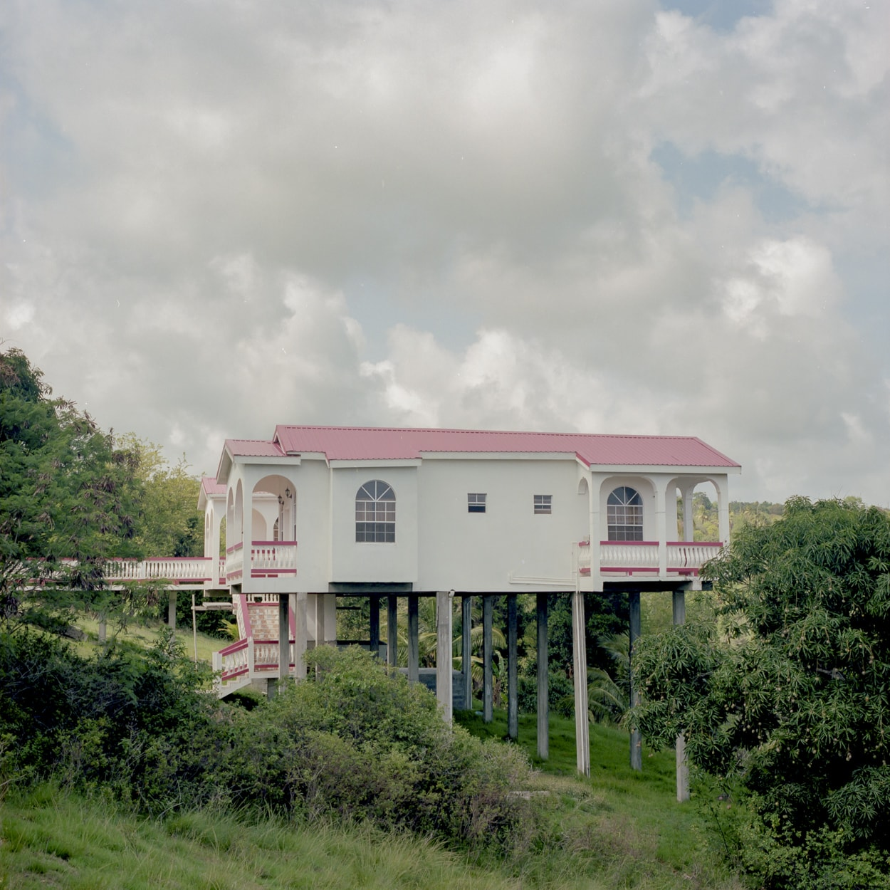 A house on stilts built on the side of a hill