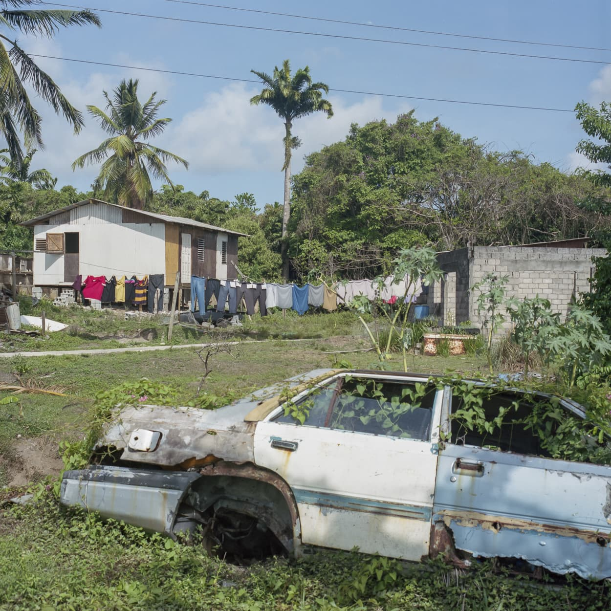 An abandoned car in a village in St. Lucia