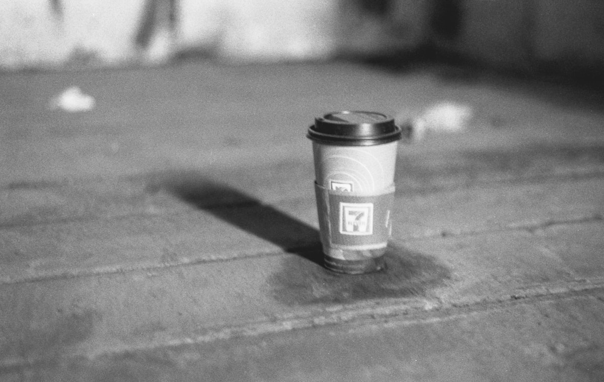 A 7-11 Coffee cup in an abandoned rail cars