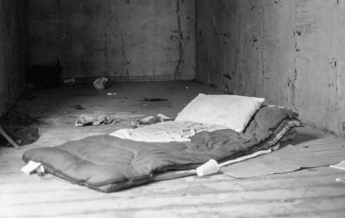 A bed in an abandoned rail cars