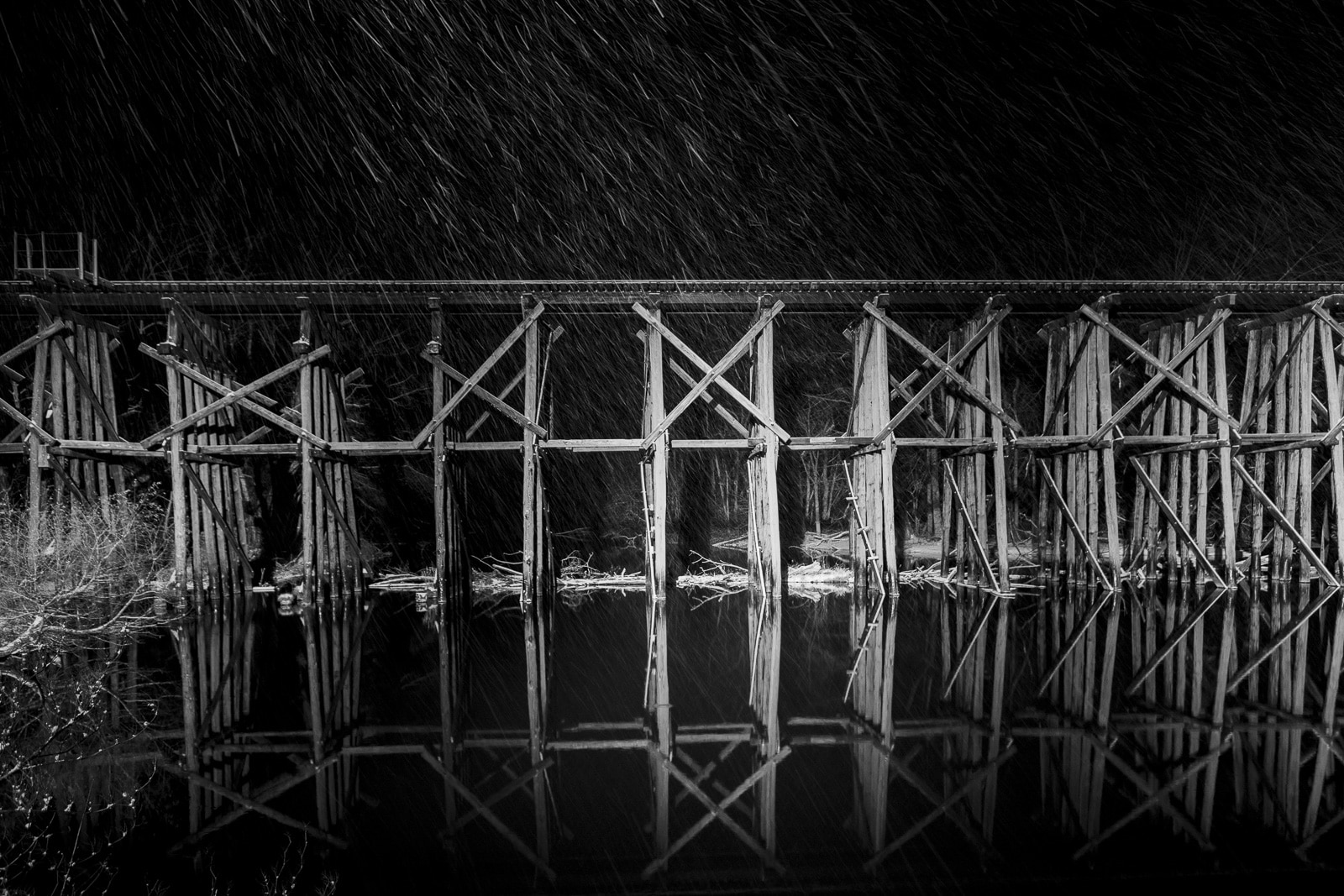 Hamilton Railroad Trestle Bridge at night in the snow