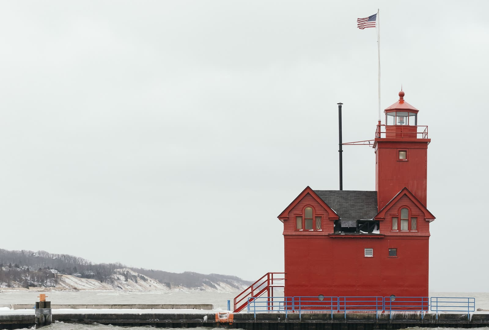 Big Red Lighthouse covered with snow in Holland, Michigan