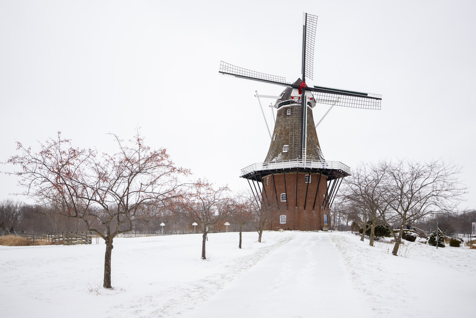 De Zwaan Windmill covered with snow at the Dutch Village in Holland, Michigan