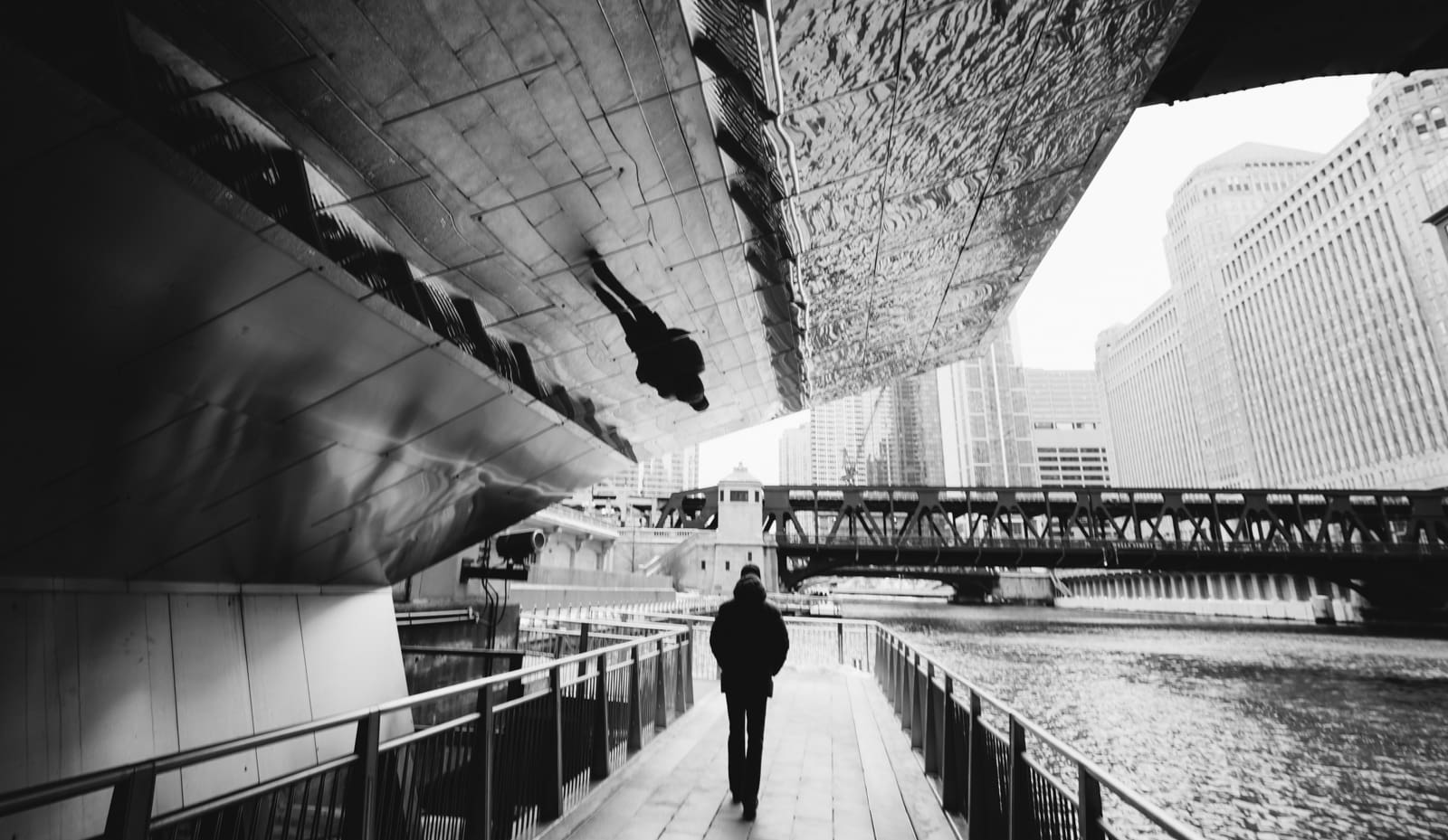 A reflection of man walking along the Chicago River in Chicago, Illinois. Best photos of 2020.