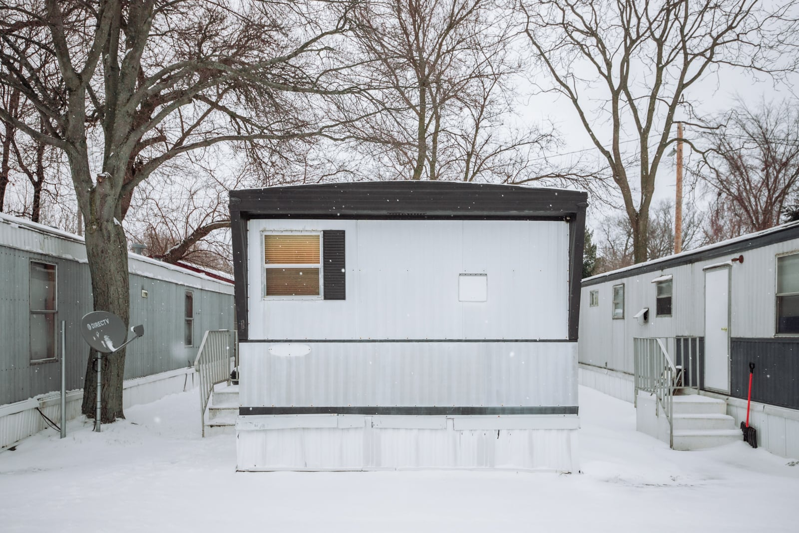 A mobile home in a trailer  park covered with snow in Holland, Michigan