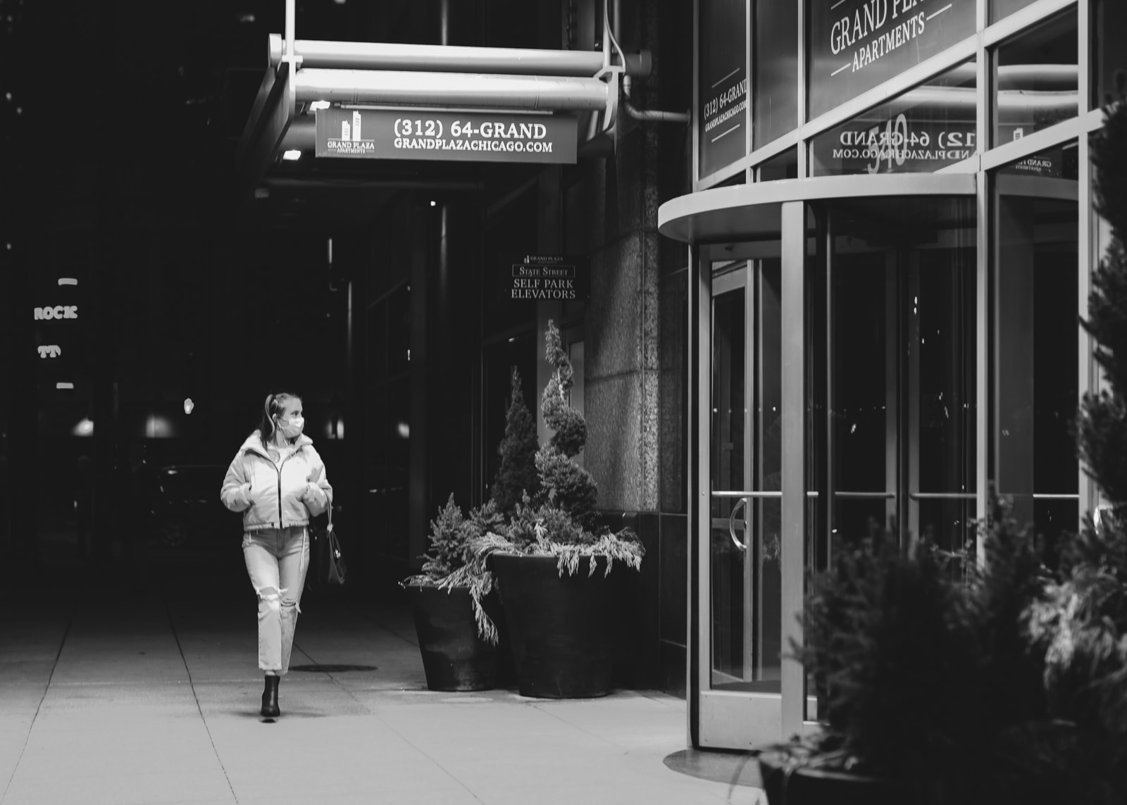 Woman walking in downtown Chicago at Night