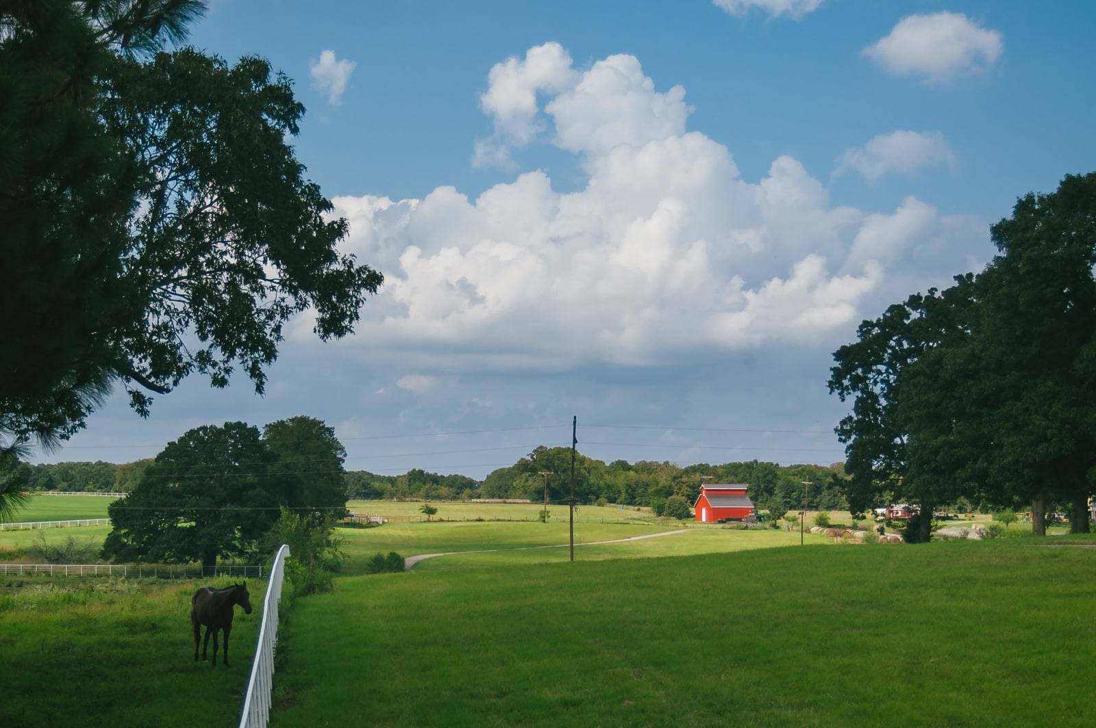 A red barn on a beautiful farm in East Texas landscape