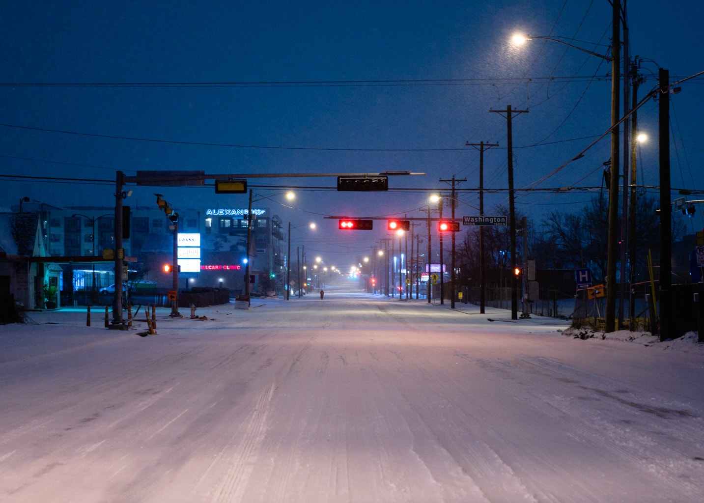 Ross Avenue in Dallas covered with snow at night