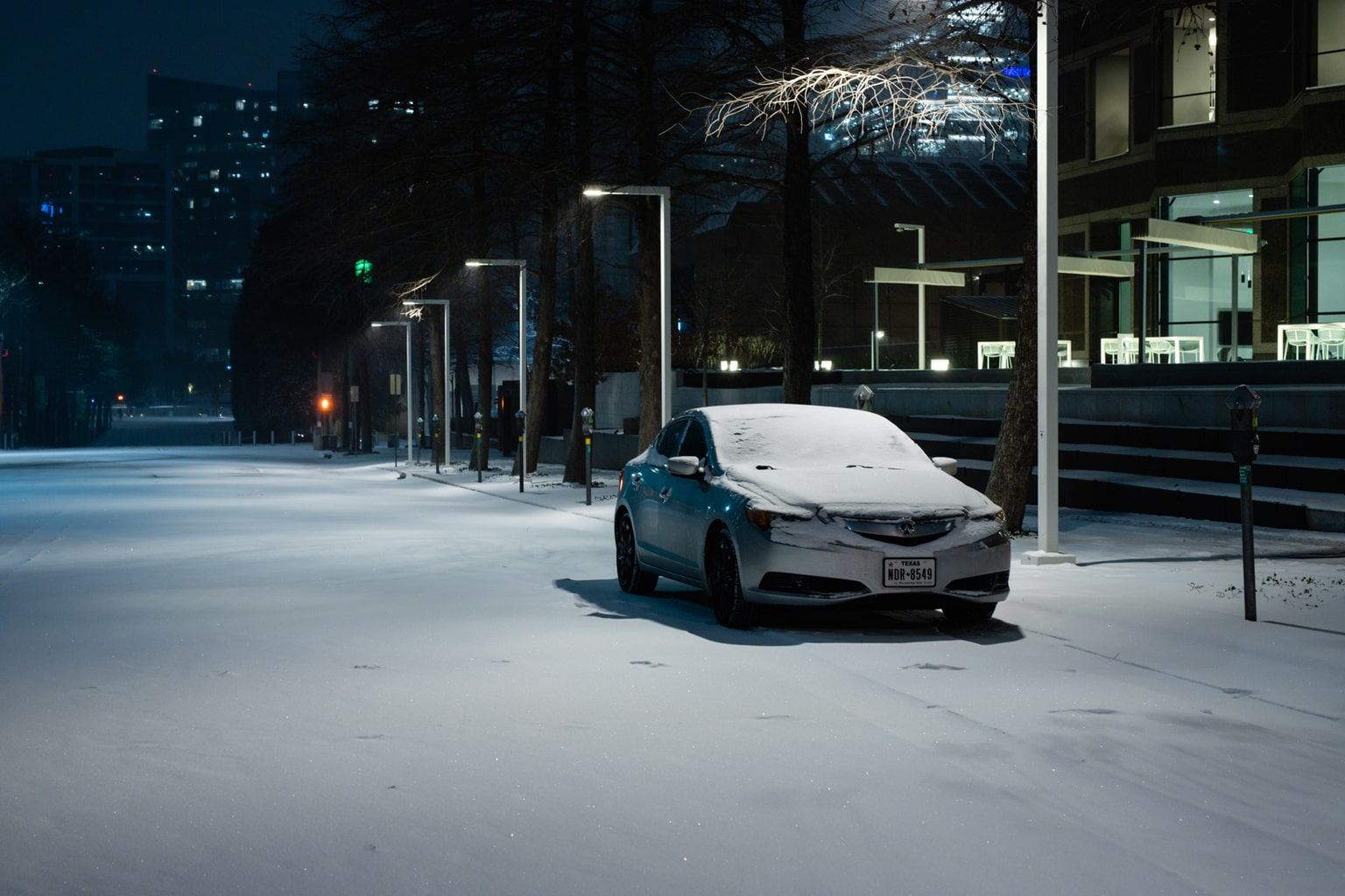 A car covered with snow in downtown Dallas