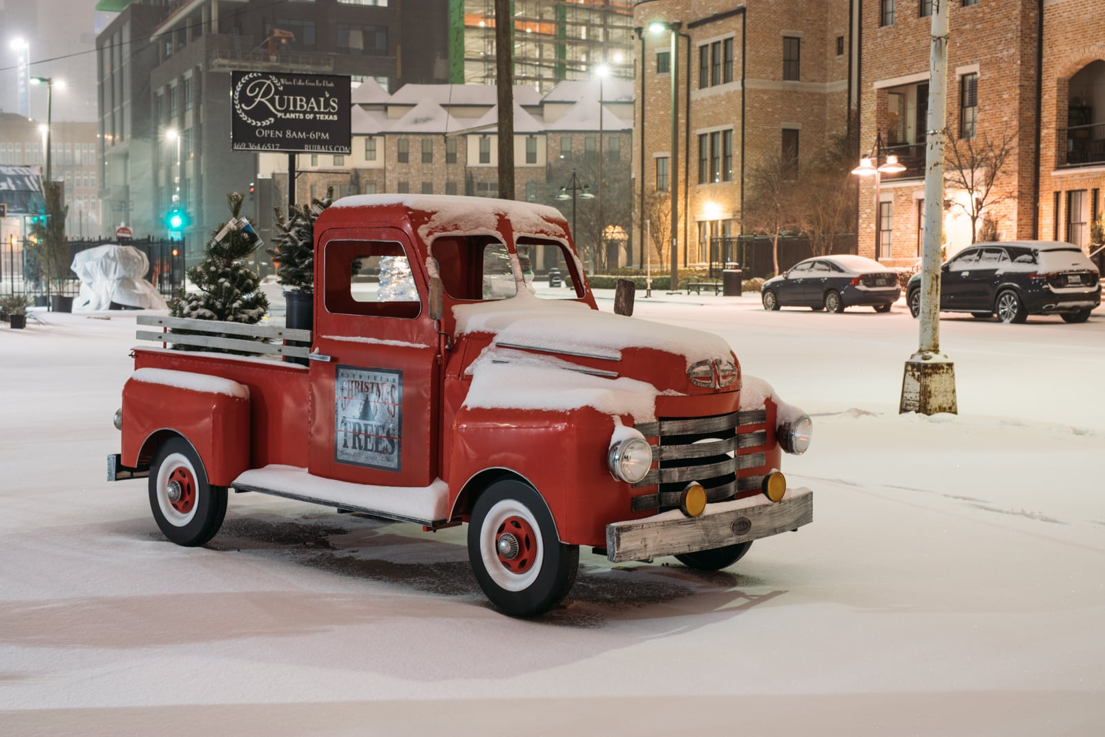 Old red pickup covered with snow in the Farmers Market in Dallas