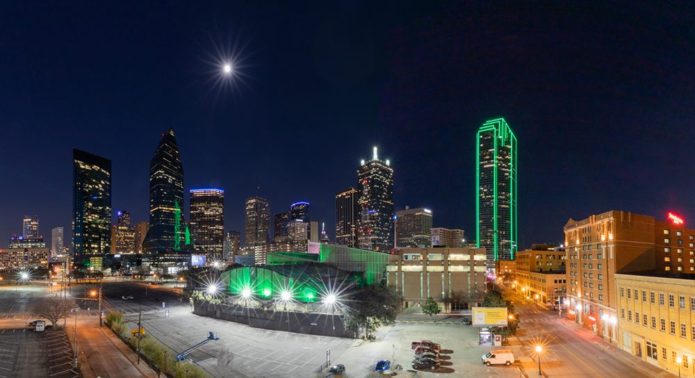 The Dallas skyline at night with the aquarium in view