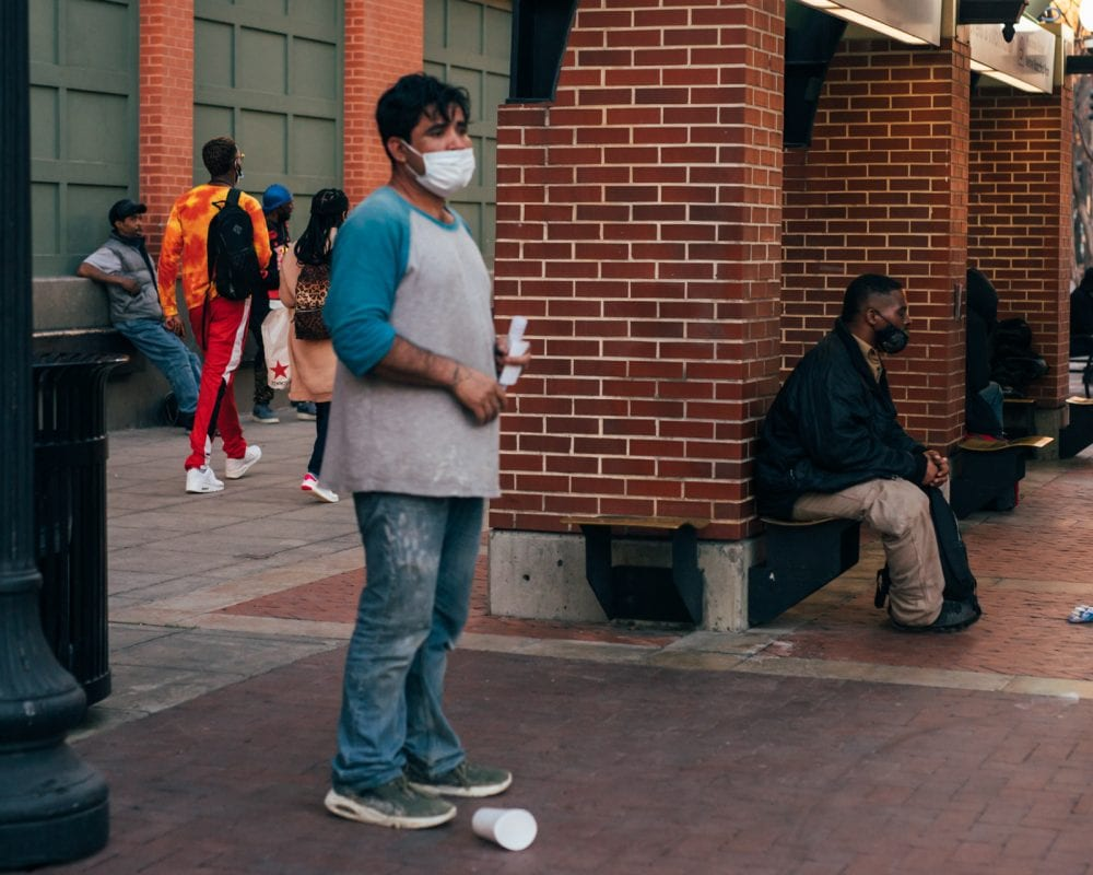 Man standing at bus station in Dallas