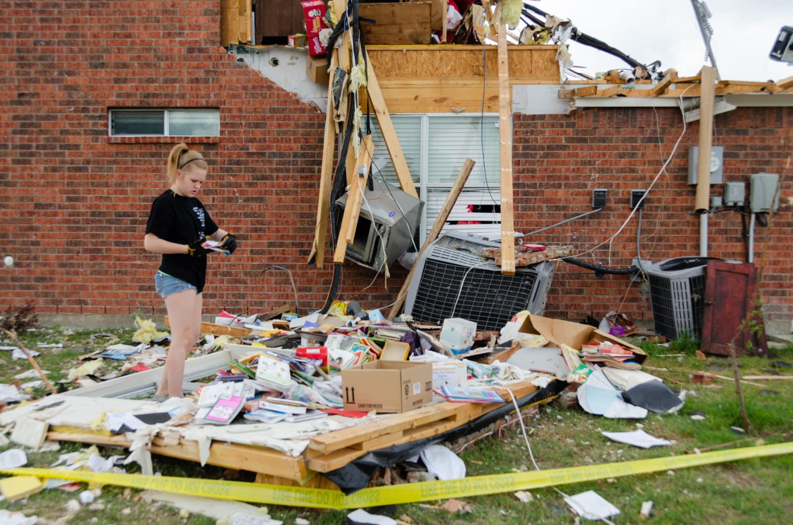 Anna Wheeler picking up her stuff after the tornado