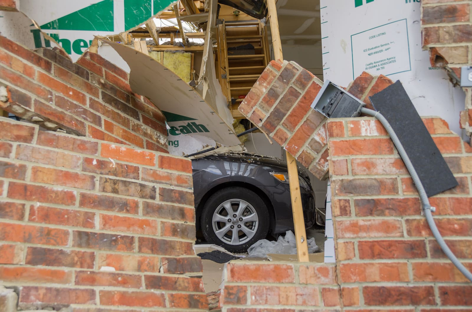 A car in a collapsed garage after a tornado in Forney, Texas