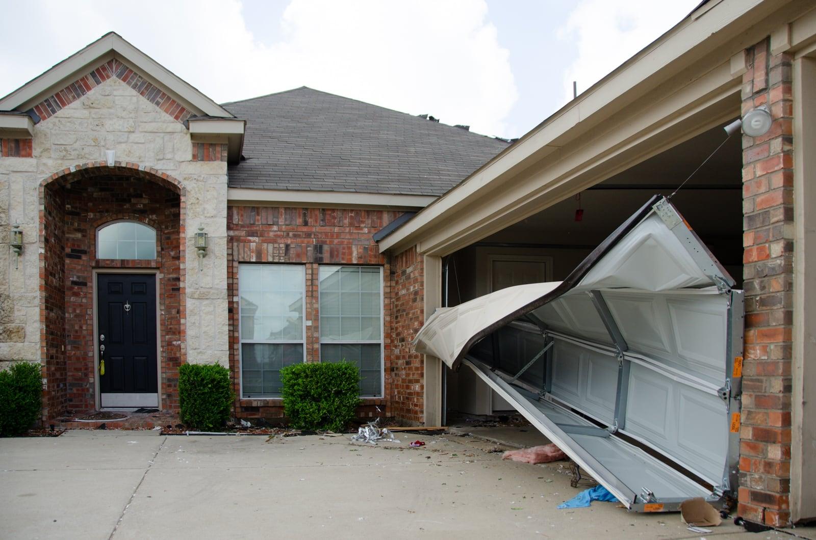 A garage door destroyed by the tornado