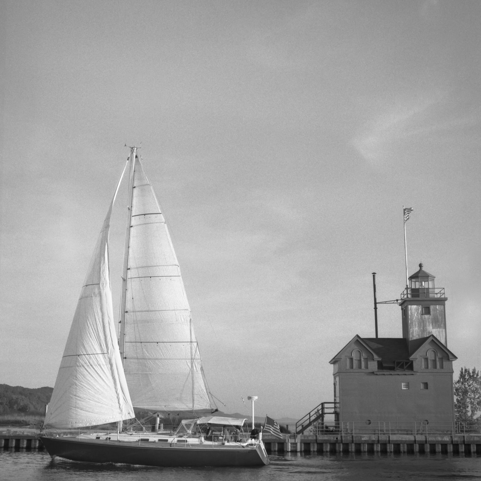 A sailboat and Big Red Lighthouse