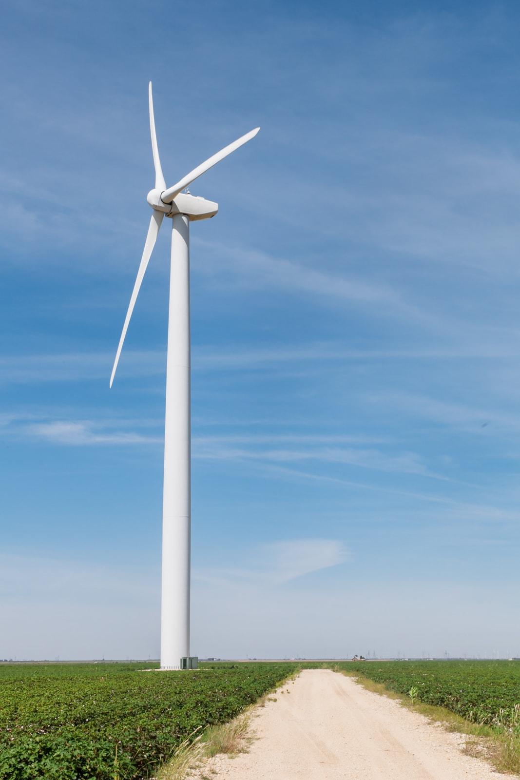 A wind turbine on a dirt road at the Roscoe Wind Farm