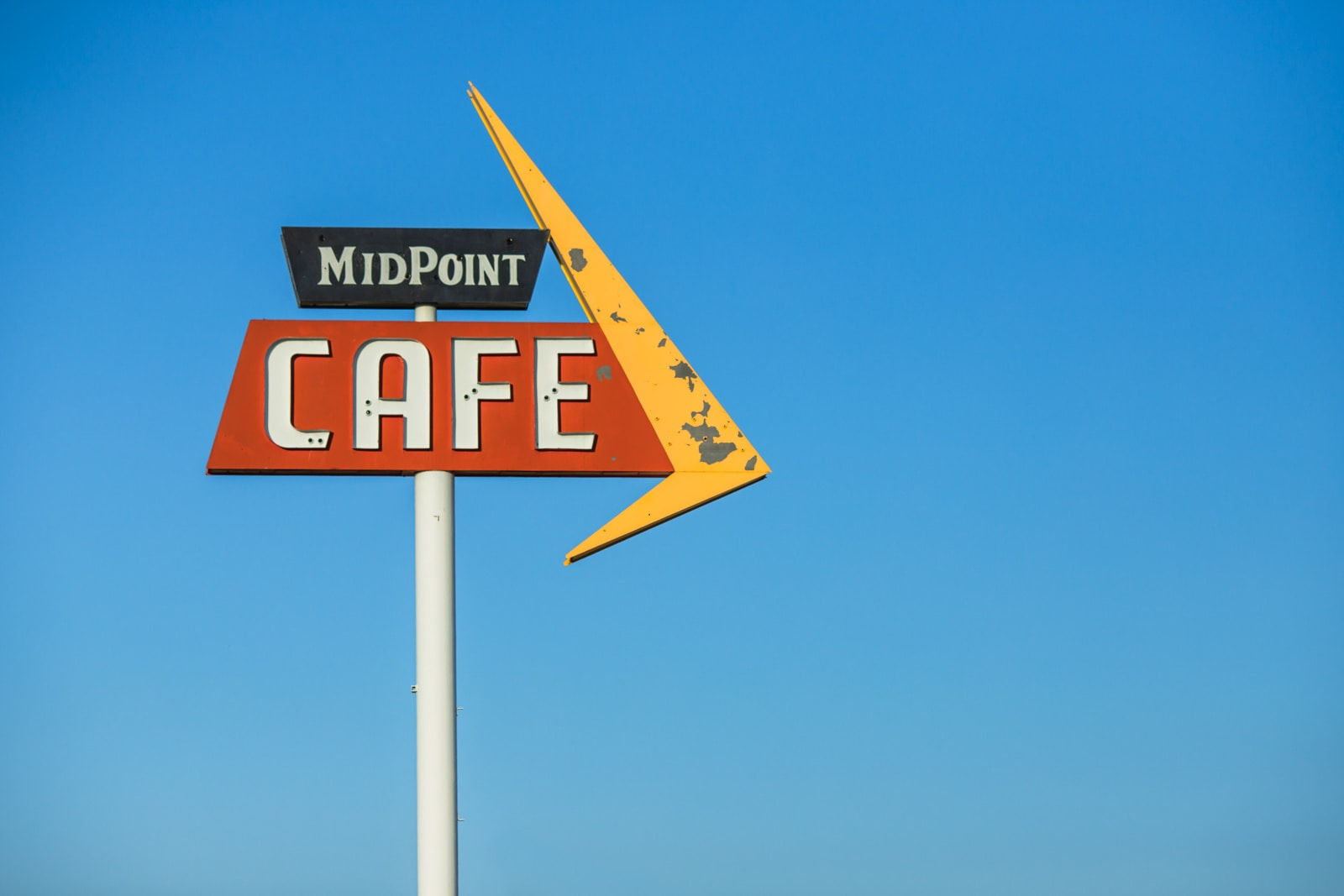 Midpoint Cafe vintage road sign