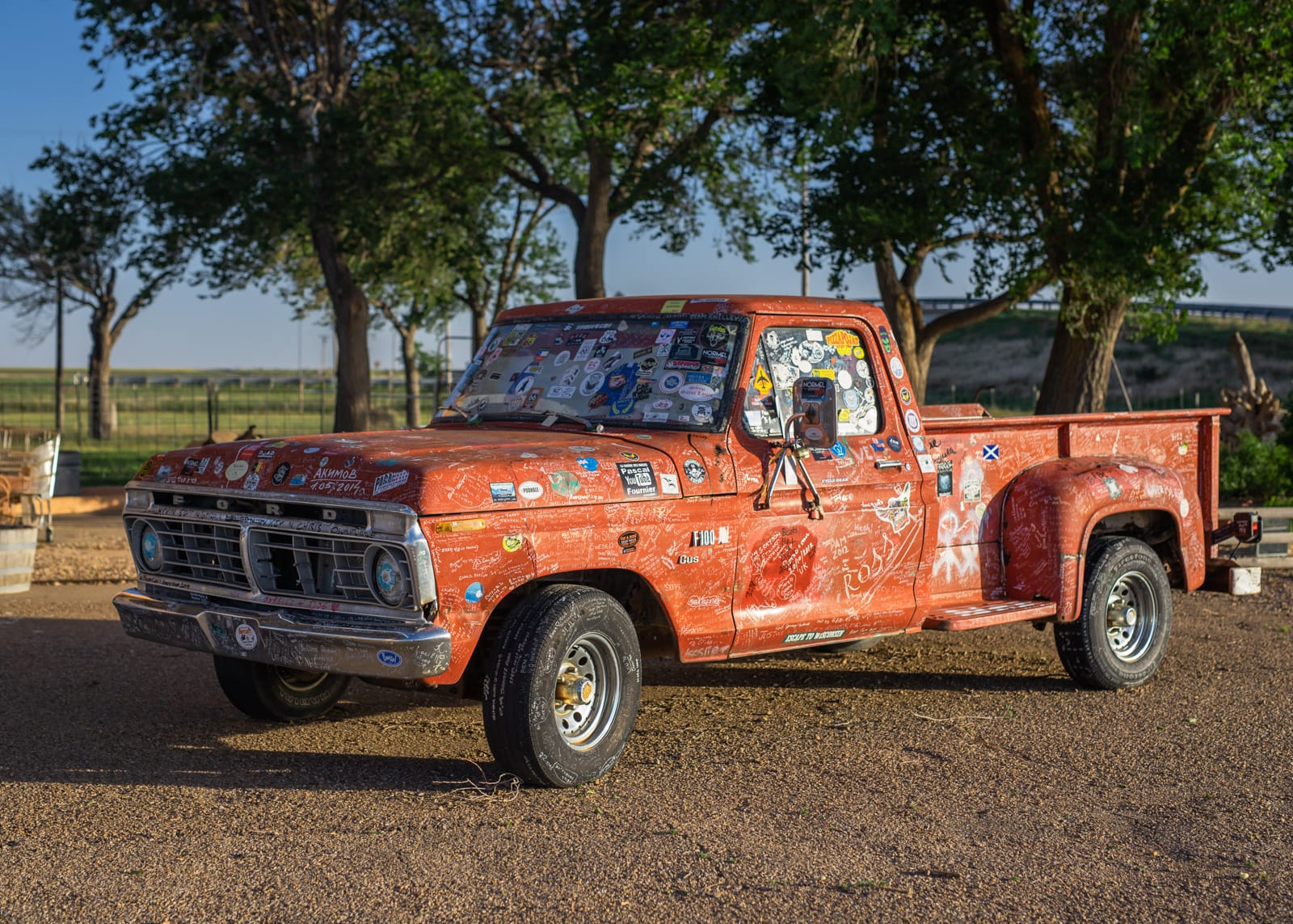 A ford truck with stickers and writing all over it in Adrian, Texas