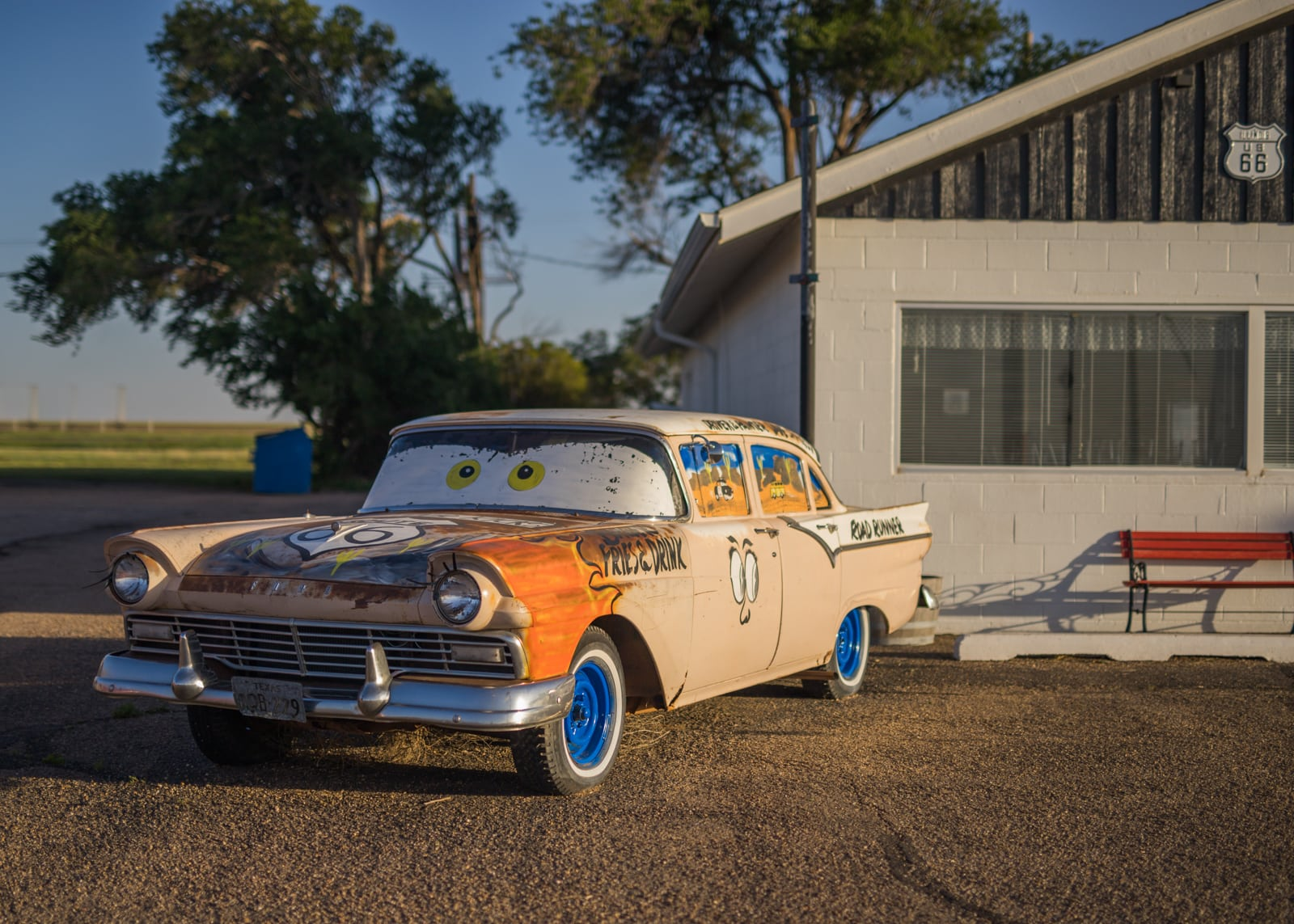 An antique car painted like a character from the Pixar movie Cars at the Route 66 Midpoint