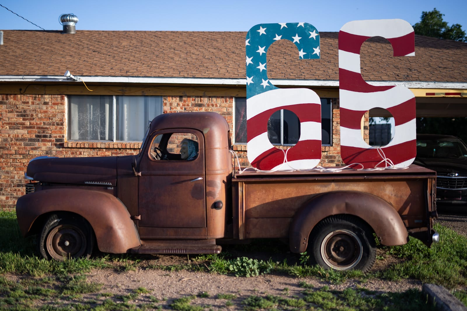 Large Route 66 numbers in a rusting vintage pickup truck