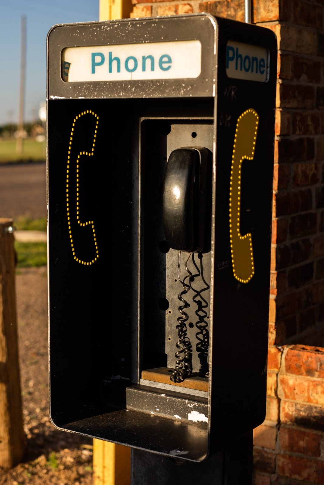 A vintage phone booth with a house phone inside of it