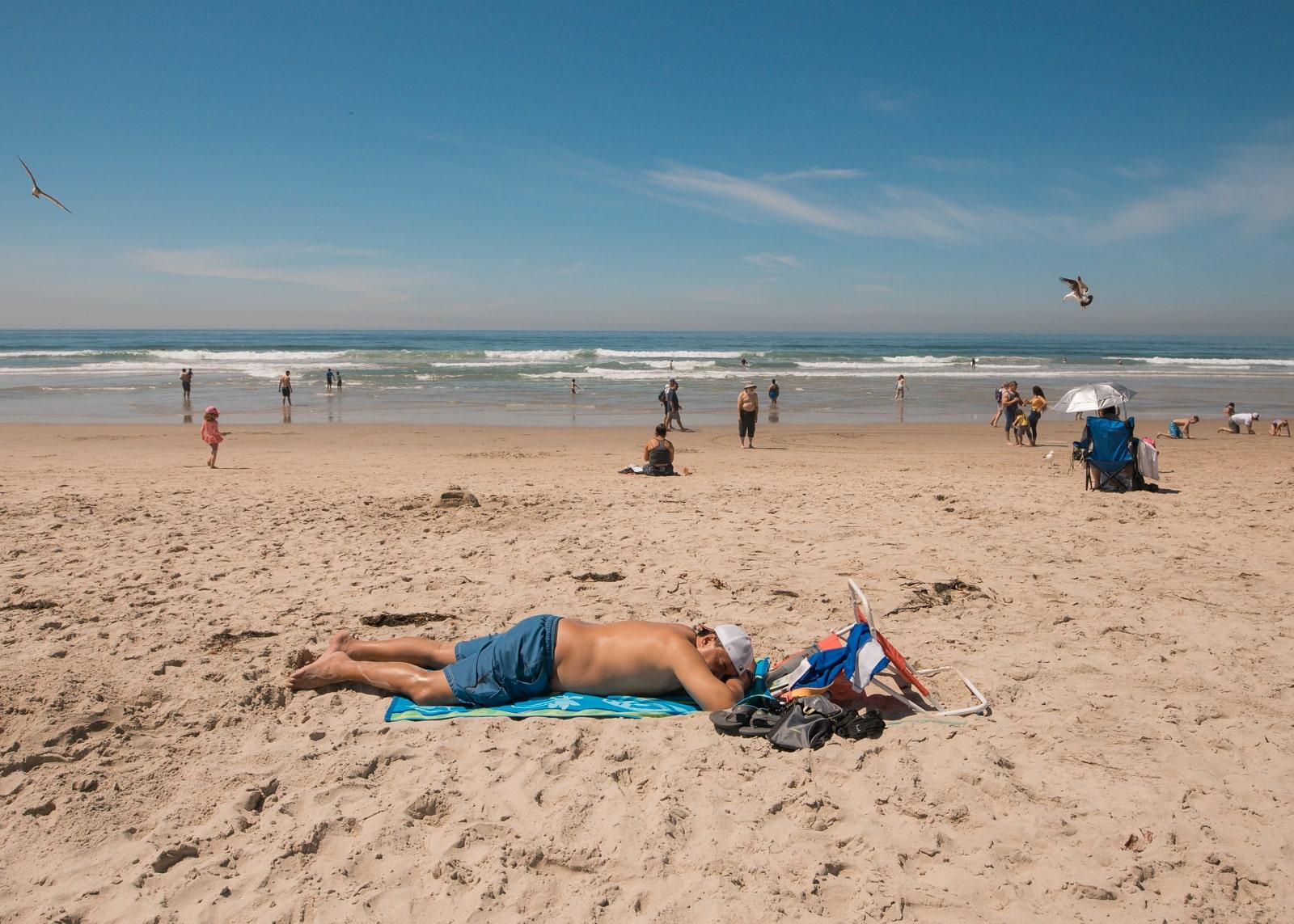 A man sleeping on the beach