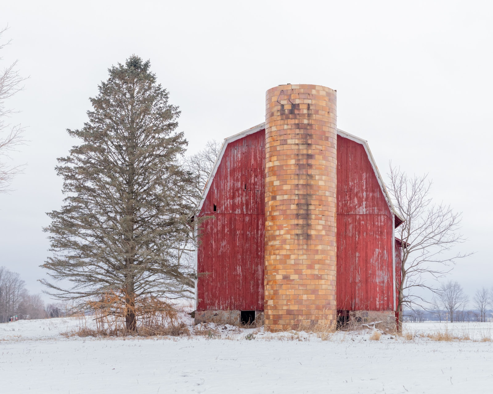 Old Red Dutch barn covered with snow, Martin, Michigan