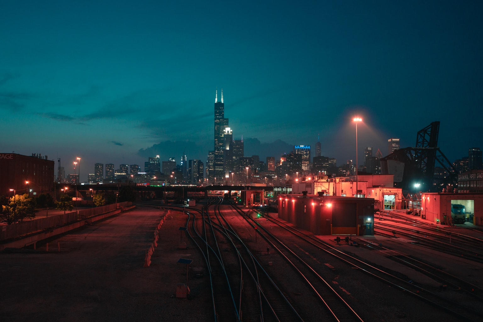 Downtown Chicago at night with railroad tracks in the foreground
