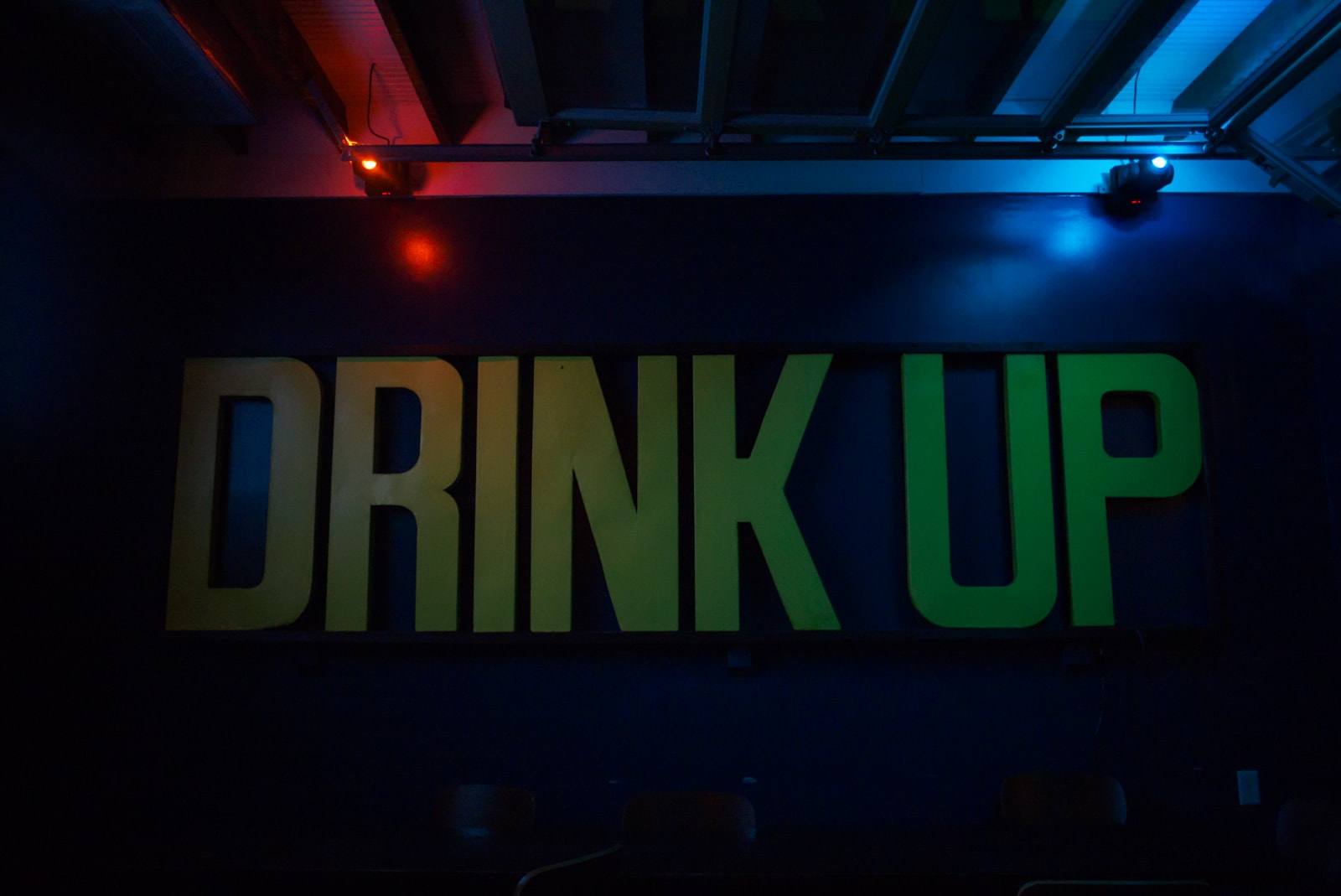 Drink Up sign in a bar