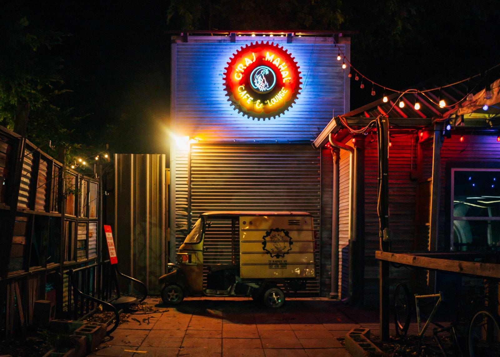 A rickshaw outside of a bar