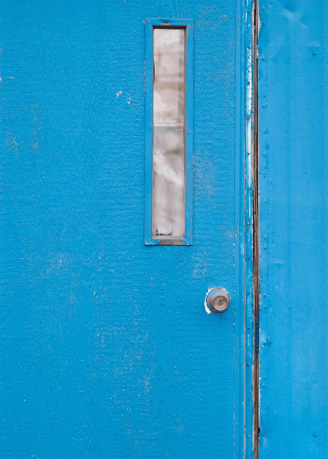 A blue mobile home door in Terrell, Texas